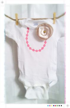 necklace onsie.  add a cute tutu and all is well
