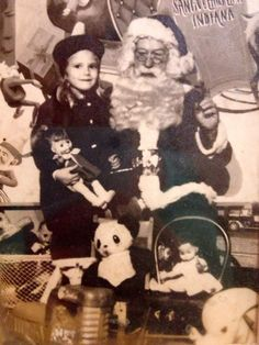 This is my favorite photo with Santa that I have in my possession. The little girl is my mom probably around 6 or 7 in the late '60s early '70s at the original Santa Claus Land.