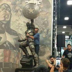 Coulson (Clark Gregg) hugging Captain America statue.