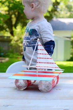 Kid made boat from recyclables- fun to make and then to play with!