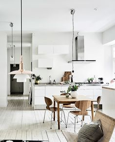 kitchen + dining room. white and wood