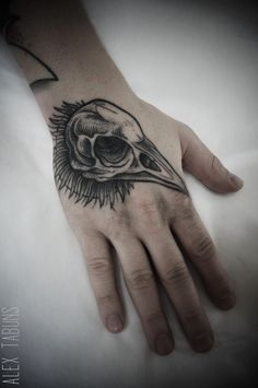 Alex Tabuns crow skull tattoo