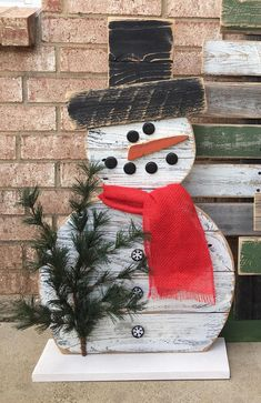 Reclaimed Wood Snowman 31 inch Snowman Reclaimed Wood, Front Porch Decor Christmas Decor Outdoor decor TREES SOLD SEPARATELY https://www.etsy.com/listing/544496416/wood-christmas-tree-front-porch-decor 31 inches tall. 18 wide Scarf is red burlap can put any color. Perfect for your front porch. Repurposed bottled caps make his eyes mouth And buttons. Made from reclaimed wood. The sign is hand painted. The sign is sanded painted and slightly distressed to give it that...