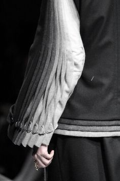 Multiplication - multiplied sleeve & cuff detail; closeup fashion design details