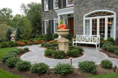 Front courtyard with focal pillar, pathway and bench
