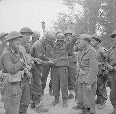 German POWs being searched during the British attack across the River Gari on the Gustav Line, Italy, 13 May 1944. Note the German with the raised hands wearing a helmet with two holes in it. He either did not wear the helmet when the strikes happened or he was the luckiest man on earth.