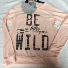 NWT Be Wild Pink Sweatshirt Brand new with attached tags. Comes rukh gloves. Available in sizes medium, large, XL and xxl. The size xxl has black gloves with flowers on them. Light peachy pink. Very soft and lightweight, good for spring! Retail $35.99. Sweaters Crew & Scoop Necks