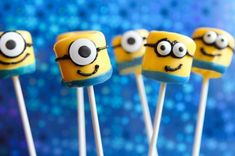 Minion pops from marshmallows dipped in yellow candy melts and a strip of blue fruit leather around the bottom!