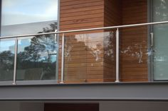 Semi Frameless Glass Balustrade with Stainless Steel posts and handrail