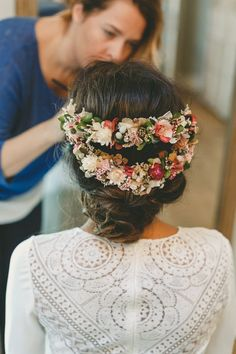 A new take on the flower crown! Pinned flowers along the sides and back of the hair in two strands, with beautiful pinned up hair at he nape of the neck ❤️