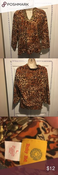 30% Off Bundles animal print brass Beaded Blouse Beautiful, unique top. Brass beads on neckline. Great condition. No marks or stains. Add three more items to your bundle for 30% off. Ruby Red Tops Blouses