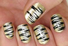 Nail tiger art look very wild and eye catching. You can paint this nail art similar to the zebra nails. The only difference is – add brown gradient . Tiger Stripe Nails, Tiger Nails, Nail Art Stripes, Tiger Stripes, Fall Nail Designs, Acrylic Nail Designs, Acrylic Nails, Nail Art 2014, Animal Nail Art