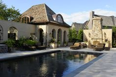 pool and outdoor fireplace