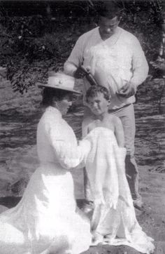 Alexei being tended to by his nanny Maria Vishnyakova and the sailor Derevenko after a swim in 1908.