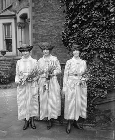 1917 - The tradition of bridesmaids wearing matching dresses dates back to ancient Rome, when bridesmaids not only wore the same dresses as each other, but also the same dress as the bride in order to act as decoys against evil spirits (and the bride's exes).  Matching striped frocks and fancy hats were worn by these bridesmaids in 1917.