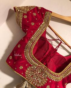 Stunning red color designer blouse with glitter hand embroidery crystals and white kundan work.Ping on 9884179863 to book an appointment. Wedding Saree Blouse Designs, Pattu Saree Blouse Designs, Silk Saree Blouse Designs, Fancy Blouse Designs, Blouse Patterns, Maggam Work Designs, Textiles, Hand Embroidery, Embroidery Stitches