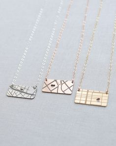 Map Necklace in Silver, Gold or Rose Gold by Olive Yew. Our little horizontal map necklace keeps that one special place close to your heart.
