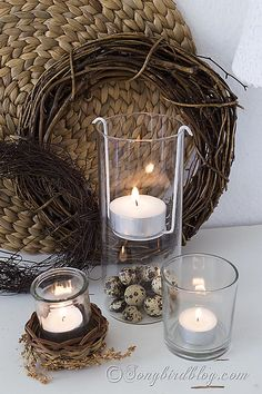 This floating tea light holder was made by repurposing a part of an old lamp shade. Clever and cute and from what I read really easy too. And that vase will travel well through the seasons. I can just see it with pinecones for Fall or shells for summer decorating. Nifty idea!
