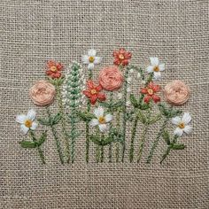 modern flowers in soft peaches, white, light green on natural linen