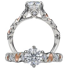Romantique diamond engagement ring featuring a prong set round cut center stone and two round cut diamonds on either side of the band with rose gold accents. $1805+