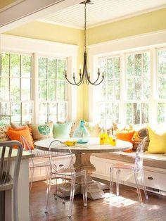 Corner Kitchen Bench with storage. Windows. White Kitchen. Round table.
