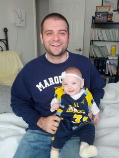 Eric Bertram, Eng '05, with daughter Eliza.