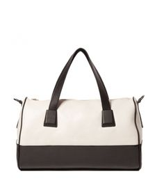DESCRIPTION:    Medium handbag with zipper and an extra shoulder strap loop of 56 centimeters. Two small inner pockets, one zipped and one flat for the mobile. Interior made of cloth. Can wear it crossed or on your shoulder.    MEASURES (H x W x depths in cm):    22 x 35 x 14    COMPOSITION:    100% Bovine