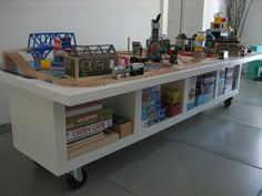 Check out this genius idea from Ikea Hackers – it creates storage for train table supplies and board games all at once!