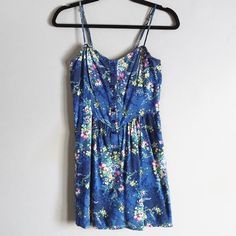 Floral summer dress from F21 Super cute blue summer dress with floral pattern. Size medium but more of a S/M. Has cute little button detailing up top and also has pockets. Would look great with a white sweater  as an Easter dress. Worn a few times but still in good condition! Also has adjustable straps. ❌no trades. Forever 21 Dresses Mini