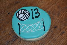 - Turquoise, white & black volleyball & net cookie