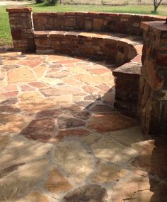 Built-In Seating. Texas Sandstone Flagstone patio & caps. Moss growing on the stone. Beautiful red & orange color!