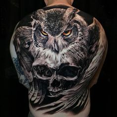 Stunning owl & skull back tattoo, a collaborative piece by Jhon Gutti and Shay Bredimus.