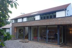 Contemporary brick portal extension with Velfac windows and insulated Sto render