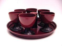 Six vintage bakelite egg cups and salt sprinkler