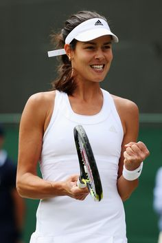 Ana Ivanovic Photos Photos - Ana Ivanovic of Serbia celebrates during her Ladies' Singles second round match against Jie Zheng of China on day four of the Wimbledon Lawn Tennis Championships at the All England Lawn Tennis and Croquet Club at Wimbledon on June 26, 2014 in London, England. - Wimbledon: Day 4