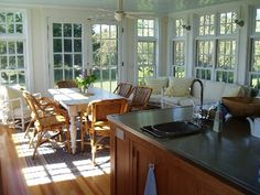 Sunroom and Kitchen with lots of windows & a big window seat:)))