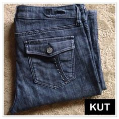 """KUT from the Kloth high rise bootleg jeans KUT from the Kloth high rise bootleg jeans. Studded back pockets and a bit on the front pocket faux pocket. Approx measurements are waist laying flat 17"""", rise 10"""", inseam 31"""", and leg opening laying flat 9 1/2"""". 98% cotton/ 2% spandex. Excellent condition!! KUT Jeans Boot Cut"""
