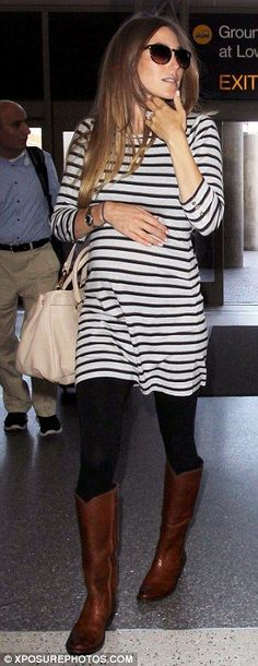 Bump chic: Jacqui looked relaxed in a tunic style striped top and leggings