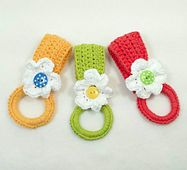 This project is a towel holder, rather than a towel topper. A towel topper combines a crocheted top that is permanently attached to a towel; a towel holder is two separate parts—the holder itself and the towel that is inserted into the crocheted ring. Having the two parts means that the towel can be removed and washed separately. Towels can also be interchangeable with the holder.