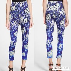 """A Brand New Jean Paul Gaultier Floral Leggings Angled darts below a high banded waist (see last pic for details) fit silky-soft leggings covered in lush indigo blooms that blur toward the cropped hems. Original was $645. Please ask any questions before purchasing.  Love reasonable offers. Thanks!  *elastic waist band *approx. 23"""" inseam *approx. 26"""" waist (front and back totals) *Pull-on style *Made in Italy Jean Paul Gaultier Pants Leggings"""