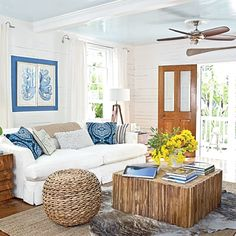 Key West Cottage Living - I like the pale blue ceiling on this room.