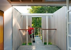 Stilted playhouse features an internal slide and climbing frame
