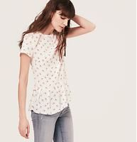 Floral Print Modern Peplum Tee - From the pleated peplum hem to the button back, this drapey floral print piece is pitch perfect. Jewel neck. Short sleeves. Banded trim at neckline. Button back.