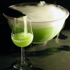 Ectoplasm Halloween Cocktail: 1 oz apple juice 2/3 oz Pisang Ambon liqueur (bright green color, tropical fruit/banana flavored liqueur) 2/3 oz lemon juice 2/3 oz vodka Lemon-lime soda