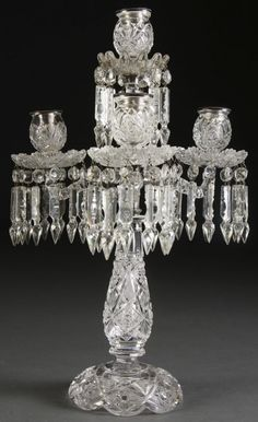 A VERY FINE AMERICAN BRILLIANT CUT GLASS 3-ARM CANDELABRA early 20th century. With baluster form stem on flaring bell-shape foot with hobnail star designs below a 3-arm scrolled candle bracket suspending cut glass pendants with silvered mounts. Height 18.5 inches.