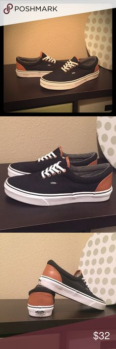Vans Low Top Canvas & Leather Sneakers Black canvas low top Vans Era skater shoes w/ tan leather uppers. Men's size 8, Women's size 9 1/2. This model can be unisex. Worn once, but can hardly tell; shoes look brand new! Vans Shoes Sneakers