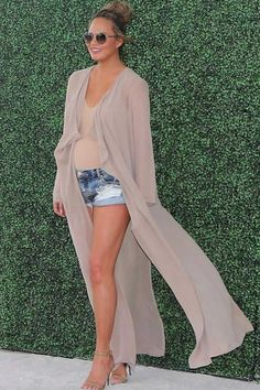A Blush Duster Coat and Nude Bodysuit Look Sleek