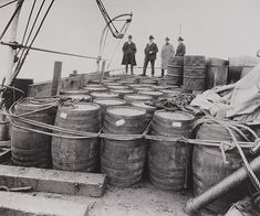 Prohibition agents examine liquor confiscated from a captured rum runner 1924 Source: Library of Congress, Prints and Photographs Division