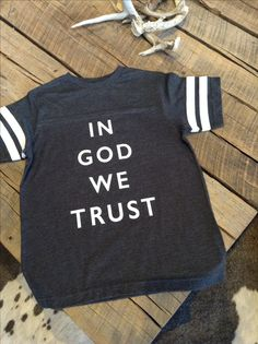 IN GOD WE TRUST FOOTBALL TEE 22.00