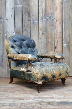 Wood and old leather  (OK! I KNOW! WHY would I love this old chair? Yet, I do!)....everyone knows I would love it,,,,B.
